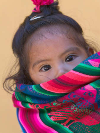 Peruvian Child Carried in Typical Aguayo (Blanket)
